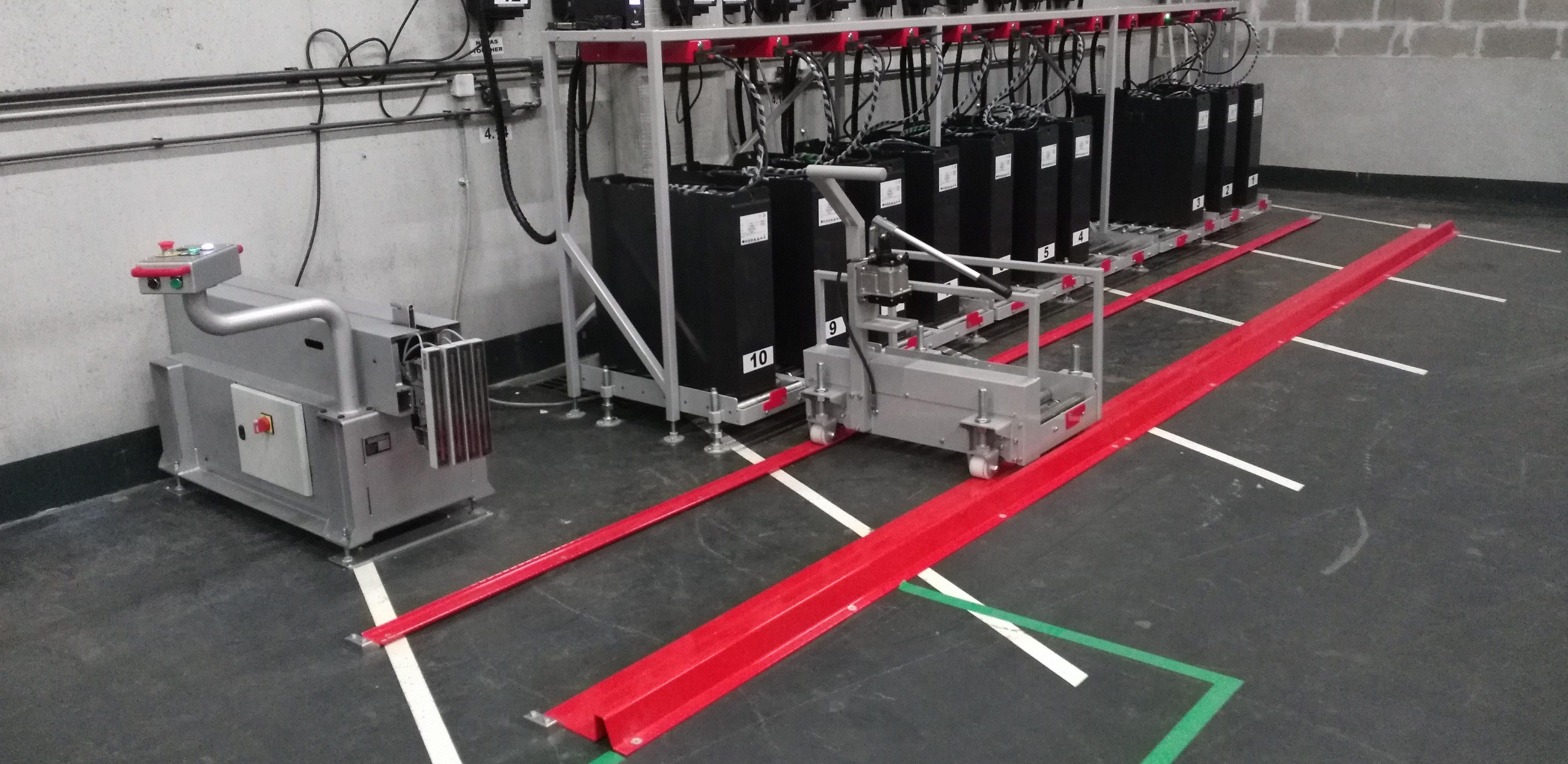 Gestion FIFO et tireur-pousseur fixe AE-TPF pour changer les batteries